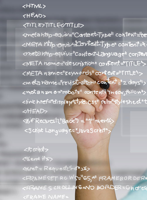 Man writing website code on a glass whiteboard