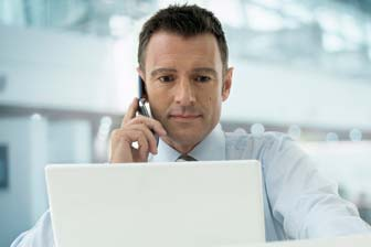 Man providing remote IT support on the phone
